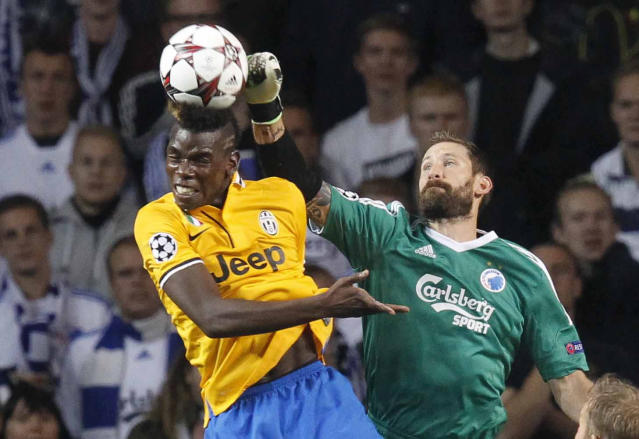 Paul Pogba of Juventus , left, and FC Copenhagen's goalkeeper Johan Viland of Sweden compete for the ball during their Champions League Group B soccer match at the Parken Stadium, Copenhagen, Denmark, Tuesday Sept. 17, 2013. (AP Photo/Polfoto/Jens Dresling)