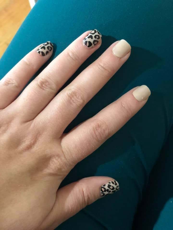 Image of woman's hand with OXX Kmart fake nails
