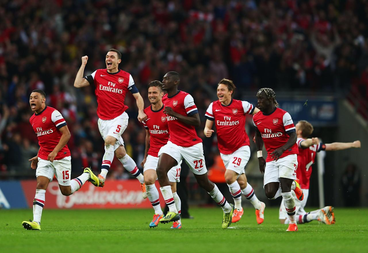 LONDON, ENGLAND - APRIL 12: Arsenal celebrate as the win 4:2 in the penalty shoot out during the FA Cup Semi-Final match between Wigan Athletic and Arsenal at Wembley Stadium on April 12, 2014 in London, England. (Photo by Michael Steele/Getty Images)