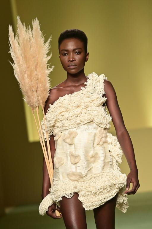 """A model presents a creation by Cameroonian fashion stylist Claudia Gisele Ntsama from the collective """"Black Lives Matter in Italian Fashion"""" in Milan during the filming of the fashion show that will open the Milan Fashion Week"""
