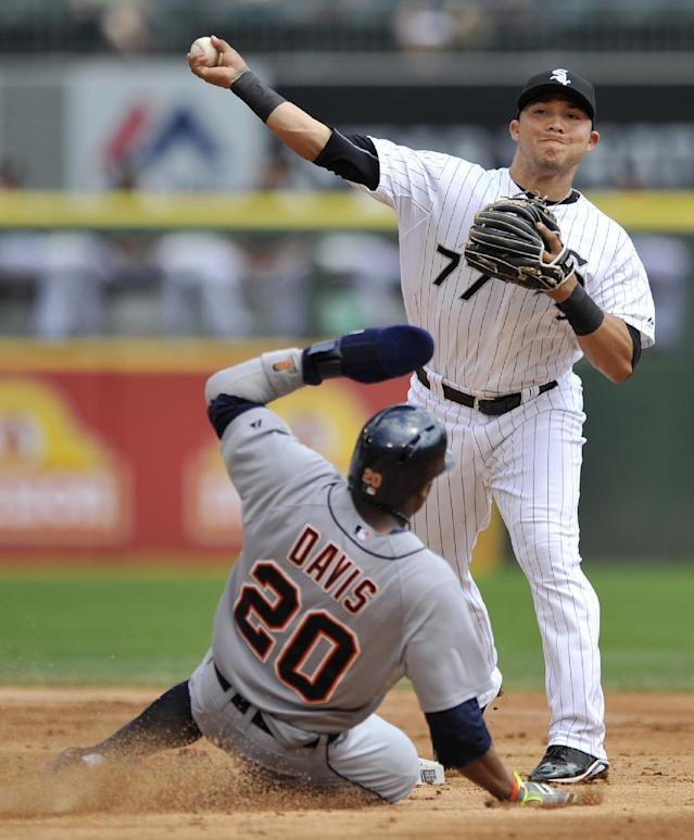 Chicago White Sox second baseman Carlos Sanchez (77), throws to first base after forcing out Detroit Tigers' Rajai Davis (20), at second base during the second inning of the first baseball game of a doubleheader in Chicago, Saturday, Aug. 30, 2014. (AP Photo/Paul Beaty)