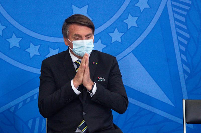 BRASILIA, BRAZIL - SEPTEMBER 02: President of Brazil Jair Bolsonaro gestures during the presentation ceremony of Plano de Contingencia para a Pessoa Idosa (Contingency Plan for the Elderly) amidst the coronavirus (COVID-19) pandemic at the Planalto Palace on September 02, 2020 in Brasilia. Brazil has over 3,950,000 confirmed positive cases of Coronavirus and has over 122,596 deaths. (Photo by Andressa Anholete/Getty Images)