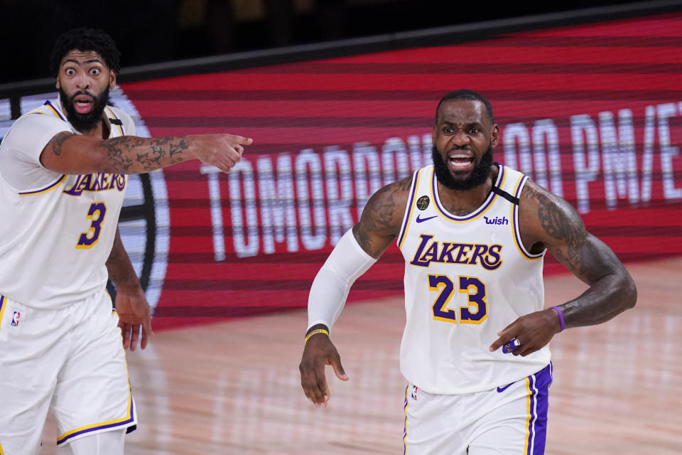 Los Angeles Lakers' LeBron James, right, and Anthony Davis are in position to win an NBA title together. (AP Photo/Mark J. Terrill)