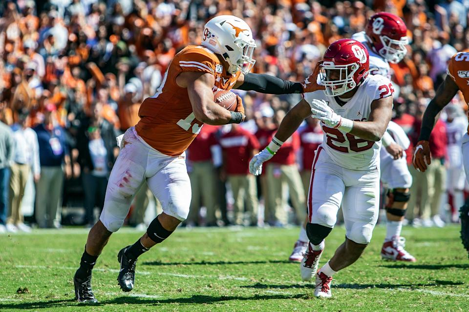 DALLAS, TX - OCTOBER 12: Texas Longhorns defensive back Brandon Jones (19) returns a pass intercepted in the end zone during a game between the Texas Longhorns and the Oklahoma Sooners on October 12, 2019, at the Cotton Bowl in Dallas, Texas. (Photo by John Korduner/Icon Sportswire via Getty Images)