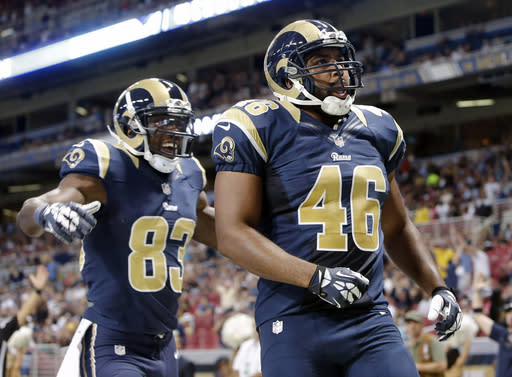 St. Louis Rams tight end Cory Harkey (46) is congratulated by wide receiver Brian Quick (83) after Harkey scored a touchdown against the New Orleans Saints on pass reception in the first quarter of a preseason NFL football game Friday, Aug. 8, 2014, in St. Louis. (AP Photo/Scott Kane)