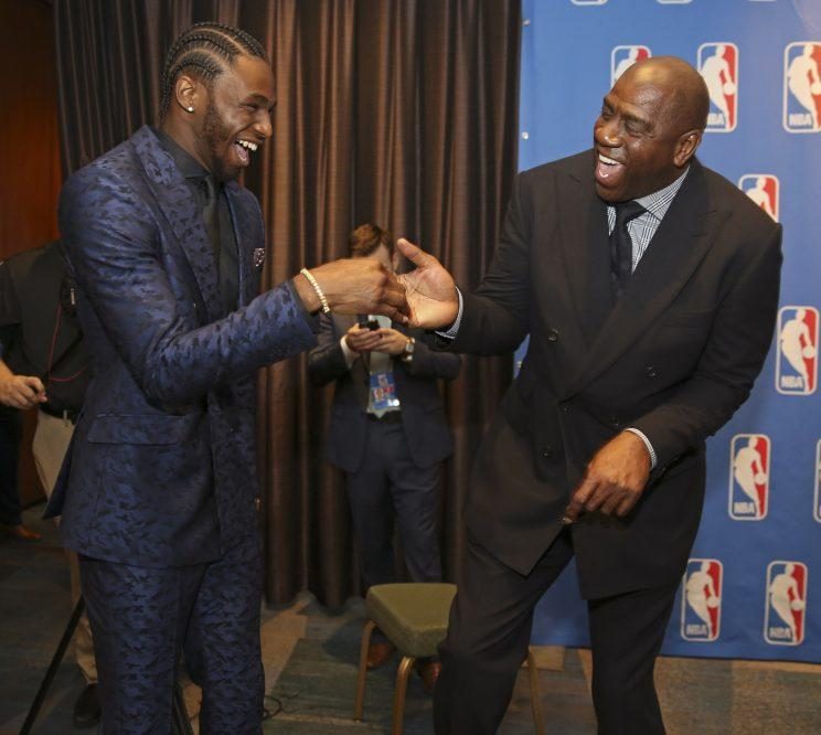 Andrew Wiggins and his main man Magic Johnson celebrate the payday that appears to be in the young Wolf's future. (Getty)