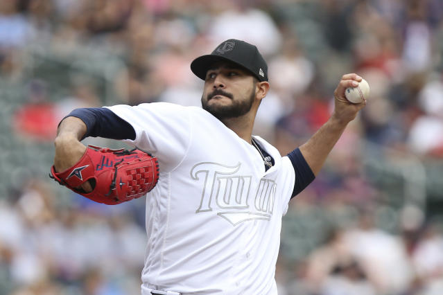 Minnesota Twins pitcher Martin Perez throws against the Detroit Tigers during the first inning of a baseball game Sunday, Aug. 25, 2019, in Minneapolis. (AP Photo/Stacy Bengs)