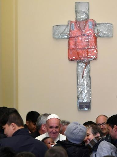 Pope Francis unveiled a resin cross adorned with the life jacket of a migrant who died last year crossing the Mediterranean