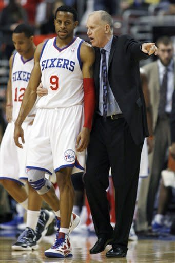 Philadelphia 76ers' Andre Iquodala (9) talks to head coach Doug Collins during the second half of an NBA basketball game, Monday, Jan, 30, 2012, in Philadelphia. The 76ers won 74-69. (AP Photo/H. Rumph Jr )