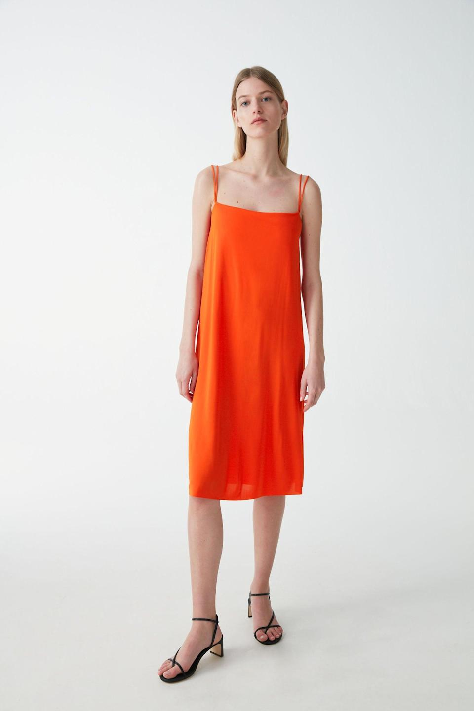"""<h2>COS Sale</h2> <br>As part of the still-simmering sale at COS, you can snag this 70%-off slip dress in a classic A-line style that was originally <a href=""""http://refinery29.com/en-us/cos-summer-sale"""" rel=""""nofollow noopener"""" target=""""_blank"""" data-ylk=""""slk:featured as a reader-favorite buy in our coverage"""" class=""""link rapid-noclick-resp"""">featured as a reader-favorite buy in our coverage</a> of the sweet summer shopping event. <br><br><em>Shop <strong><a href=""""https://www.cosstores.com/en_usd/women/sale.html"""" rel=""""nofollow noopener"""" target=""""_blank"""" data-ylk=""""slk:COS"""" class=""""link rapid-noclick-resp"""">COS</a></strong></em><br><br><strong>COS</strong> A-line Slip Dress, $, available at <a href=""""https://go.skimresources.com/?id=30283X879131&url=https%3A%2F%2Fwww.cosstores.com%2Fen_usd%2Fwomen%2Fwomenswear%2Fdresses%2Fproduct.a-line-slip-dress-orange.0902234002.html"""" rel=""""nofollow noopener"""" target=""""_blank"""" data-ylk=""""slk:COS"""" class=""""link rapid-noclick-resp"""">COS</a><br><br><br>"""