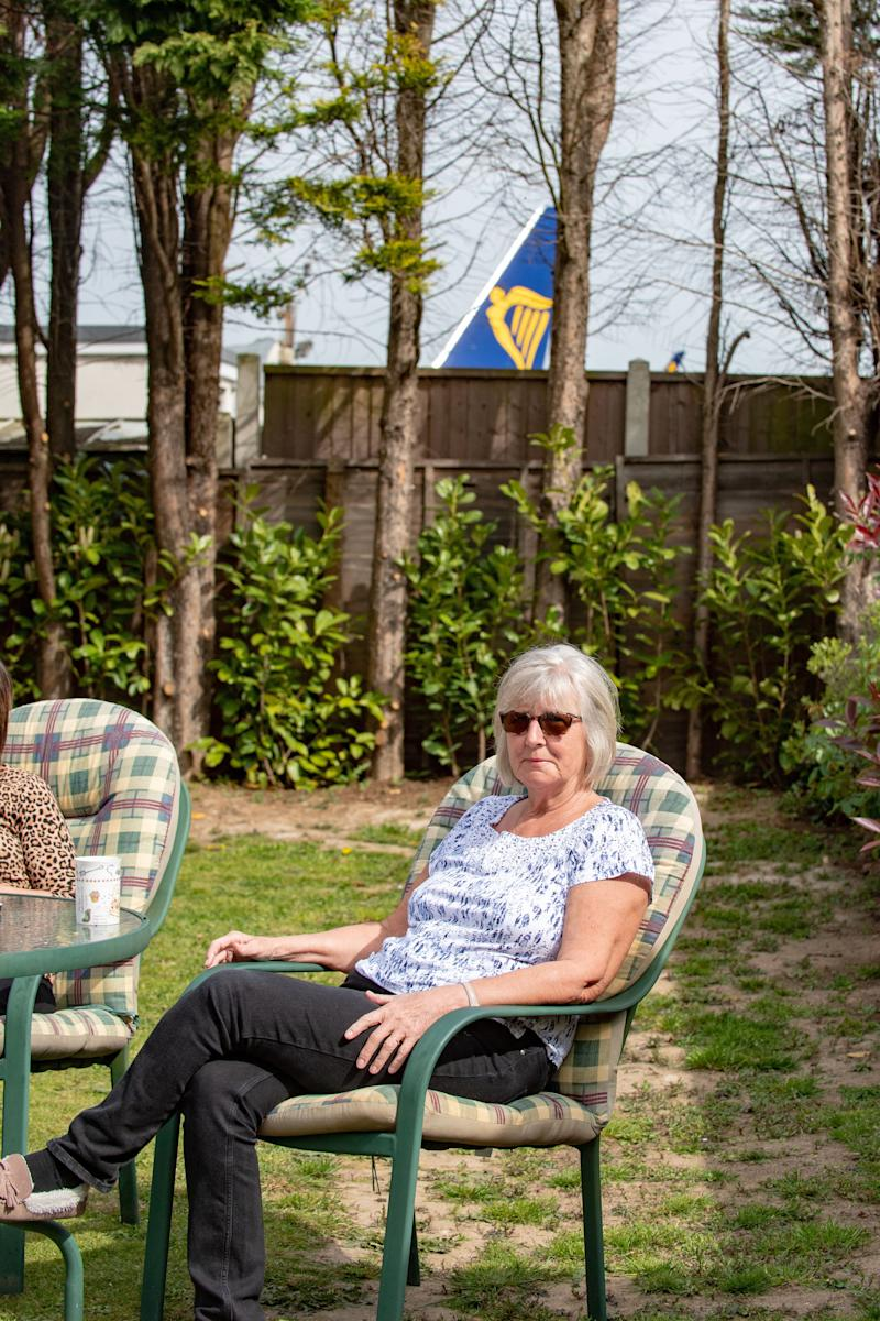 Janet Marchant, 67 in her garden which backs on to Southend Airport in Essex. (SWNS)