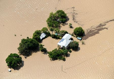 A property is surrounded by floodwaters caused by Cyclone Debbie near Rockhampton, Australia, April 6, 2017.    AAP/Dan Peled/via REUTERS