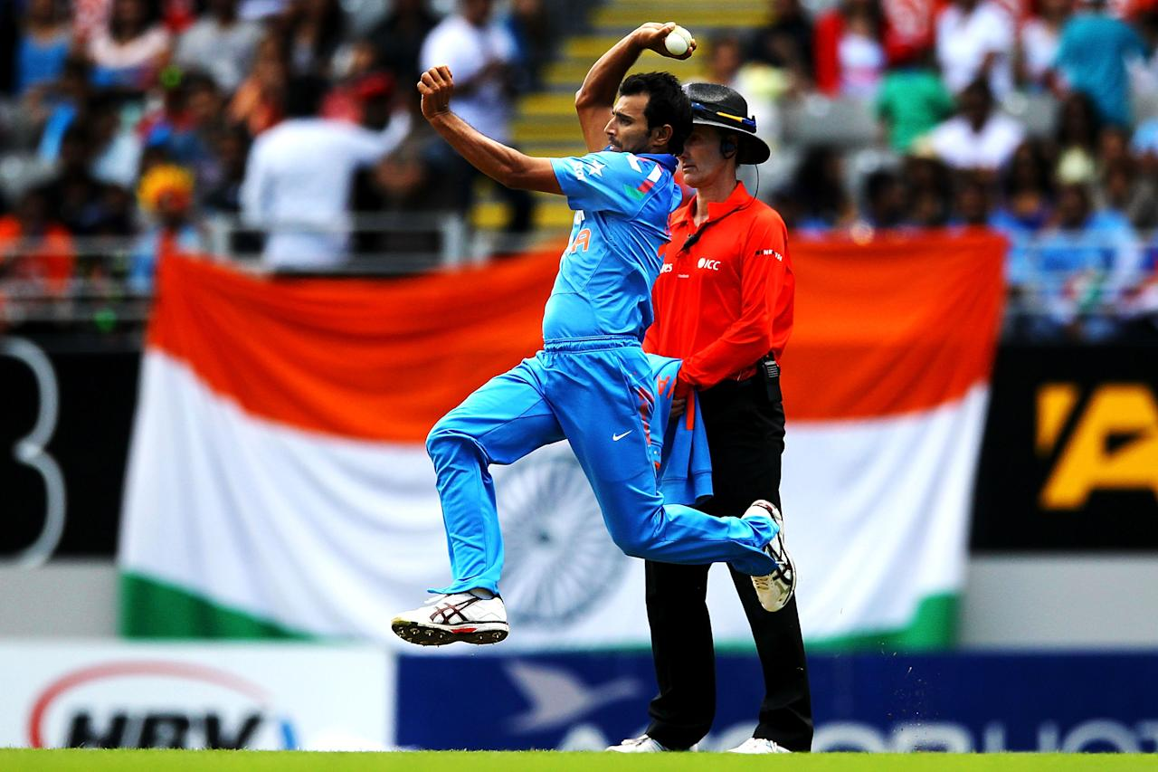 AUCKLAND, NEW ZEALAND - JANUARY 25: Mohammed Shami of India bowls during the One Day International match between New Zealand and India at Eden Park on January 25, 2014 in Auckland, New Zealand.  (Photo by Anthony Au-Yeung/Getty Images)