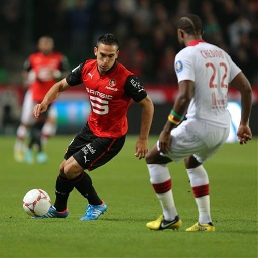 Turkish forward Mevlut Erding challenges for the ball with Lille's defender Chedjou during their french League One soccer match in Rennes, western France, Friday, Sept. 28, 2012. (AP Photo/David Vincent)
