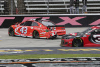 Bubba Wallace slides along the track during the NASCAR Cup Series auto race at Texas Motor Speedway in Fort Worth, Texas, Wednesday, Oct. 28, 2020. (AP Photo/Richard W. Rodriguez)