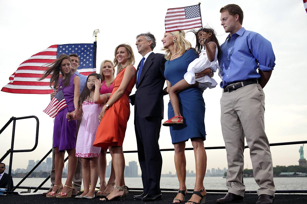 JERSEY CITY, NJ - JUNE 21:  Republican Jon Huntsman (C) stands on stage with members of his family after announcing his bid for the presidency at Liberty State Park June 21, 2011 in Jersey City, New Jersey. Huntsman, until recently the U.S. ambassador to China under President Obama, emphasized his record as a two-term governor of Utah.  (Photo by Spencer Platt/Getty Images)