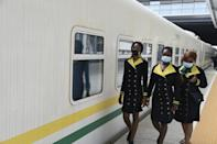 Hostesses arrive onboard the train. The fledgling service currently only operates once a day -- the goal is to increase trains and beef up speed to 160kph