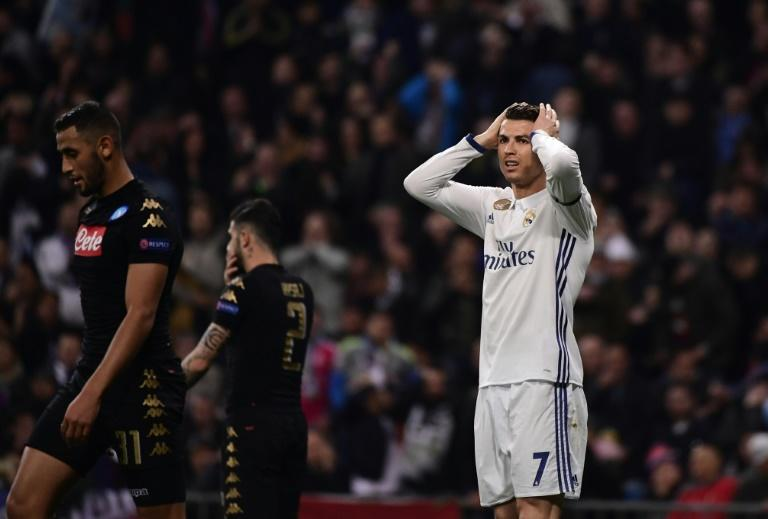 Real Madrid's forward Cristiano Ronaldo (R) gestures during the UEFA Champions League round of 16 first leg football match against SSC Napoli February 15, 2017