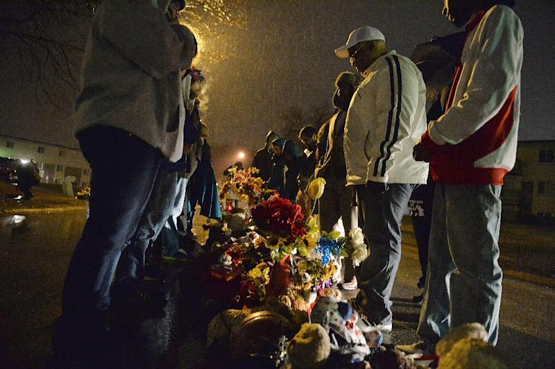 A small group of protestors gather at the memorial for Michael Brown Jr. at Canfield Apartments in Ferguson, Missouri on March 13, 2015 (AFP Photo/Michael B. Thomas)