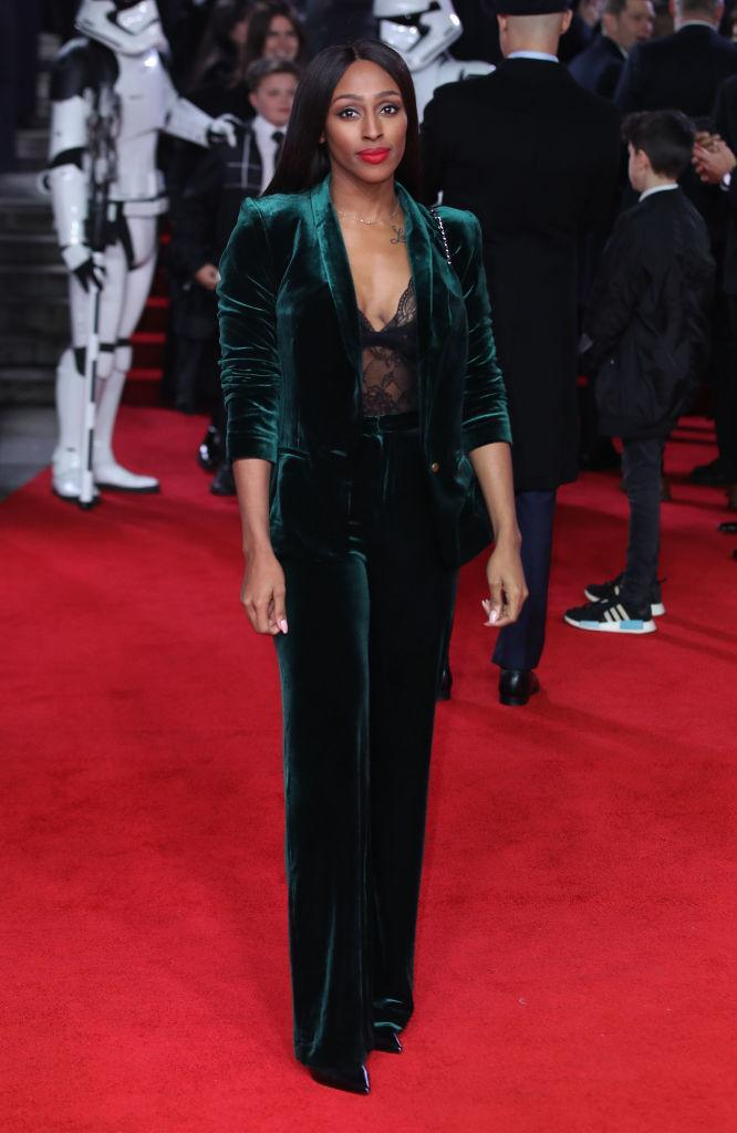 <p>Alexandra Burke manages to look chic and cozy in this gem-colored velvet take on a power suit. (Photo: Getty Images) </p>