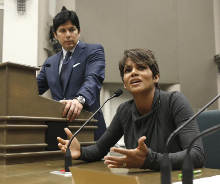 FILE - In this Aug. 13, 2013, file photo, actress Halle Berry urges lawmakers to support a bill that would limit the ability of paparazzi to photograph children of celebrities and public figures, at the Capitol in Sacramento, Calif. The bill, by state Sen. Kevin de Leon, D-Los Angeles, left, was approved by the Legislature and signed by Gov. Jerry Brown, is one of the more than 800 new laws to take effect Jan. 1. (AP Photo/Rich Pedroncelli, File)