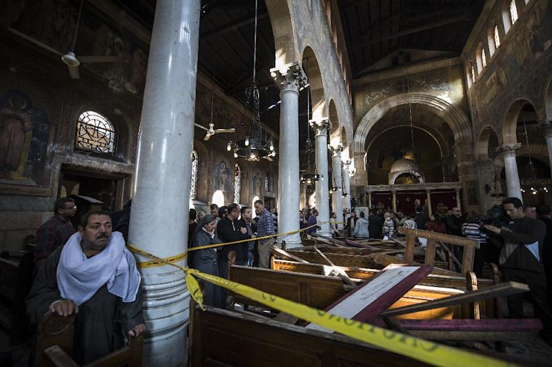 Egypt is trying to come to terms with the kind of religious bigotry behind a suicide bombing in the Saint Peter and Saint Paul Coptic church in Cairo that killed 26 (AFP Photo/KHALED DESOUKI)