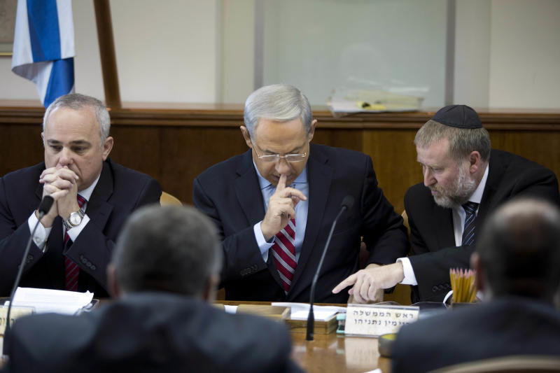 Israeli Prime Minister Benjamin Netanyahu chairs the weekly cabinet meeting at his office in Jerusalem, Israel, Sunday, Nov. 24, 2013. After feverishly trying to derail the international community's nuclear deal with Iran in recent weeks, Israeli Prime Minister Benjamin Netanyahu now has little choice but to accept an agreement that he has derided as deeply flawed. (AP Photo/Abir Sultan, Pool)