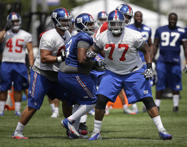 New York Giants guard John Jerry (77) blocks during NFL football camp in East Rutherford, N.J., Tuesday, July 22, 2014. (AP Photo/Seth Wenig)