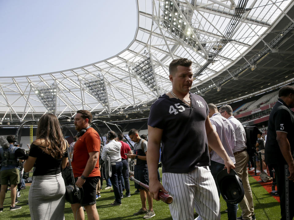 New York Yankees first baseman Luke Voit walks off the field after batting practice in London, Friday, June 28, 2019. Major League Baseball will make its European debut with the New York Yankees versus Boston Red Sox game at London Stadium this weekend. (AP Photo/Tim Ireland)