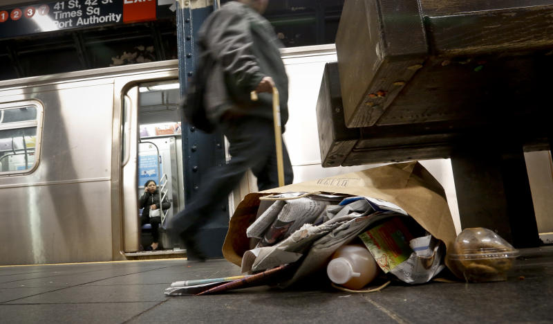 Garbage collects near a set of benches on a subway platform, Thursday March 30, 2017, in New York. Faced with the problem of too much litter and too many rats in their subway stations, New York City transit officials began an unusual social experiment a few years ago. They removed trash bins entirely from select stations, figuring it would deter people from bringing garbage into the subway in the first place. This week, they pulled the plug on the program after reluctantly concluding that it was a failure. (AP Photo/Bebeto Matthews)