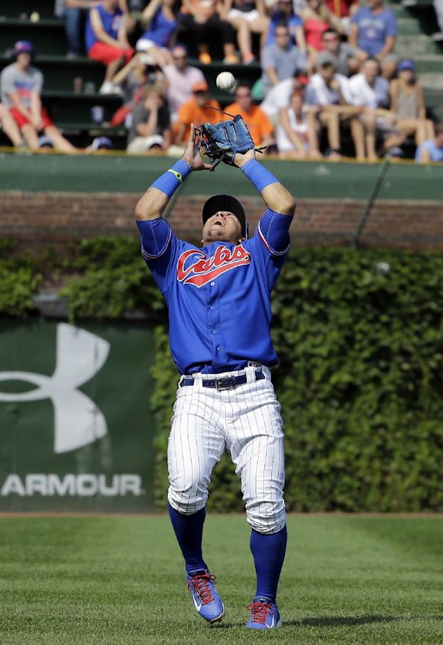 Chicago Cubs shortstop Javier Baez catches a fly ball hit by Baltimore Orioles' Jonathan Schoop during the eighth inning of an interleague baseball game in Chicago, Sunday, Aug. 24, 2014. (AP Photo/Nam Y. Huh)