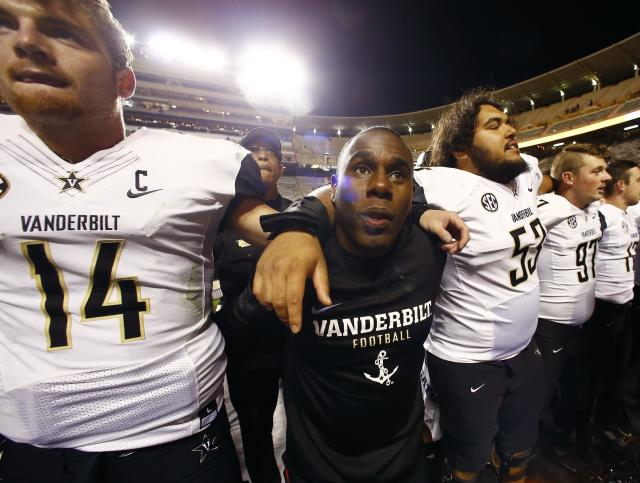 FILE - In this Nov. 25, 2017, file photo, Vanderbilt head coach Derek Mason celebrates with his team after an NCAA college football game, in Knoxville, Tenn. Minorities make up only 19 percent of Division I head football coaches and less across the Power Five conferences: the ACC, SEC, Big Ten, Big 12 and Pac 12. But the Champion Forum has helped Penn States James Franklin, Vanderbilts Derek Mason, Stanfords David Shaw, Arizonas Kevin Sumlin and others get head jobs with the aim of pushing the next generation along, too. (AP Photo/Wade Payne, File)