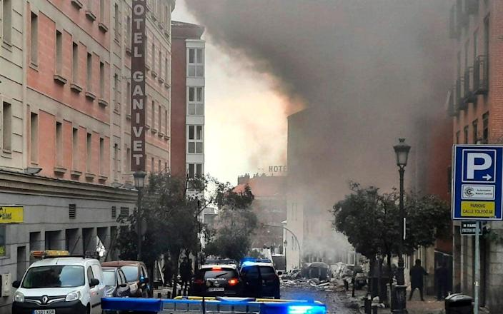 Smoke rises from a building and rubble scattered in Toledo Street following a explosion in downtown Madrid - Europa Press