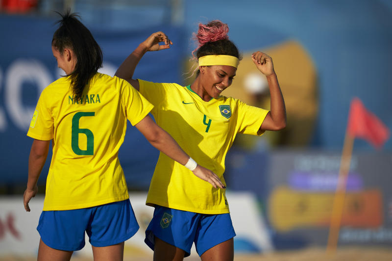 DOHA, QATAR - OCTOBER 15: Adriele Rocha of Brazil celebrates after scoring with her teammate Nayara Virginia during the Women's semi final match between Great Britain and Brazil during day fourth of the ANOC World Beach Games Qatar 2019 at Katara Beach on October 15, 2019 in Doha, Qatar. (Photo by Quality Sport Images/Getty Images)
