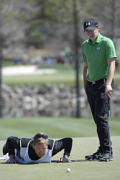 Matthew Fitzpatrick, right, of England, watches as his caddie helps line up a putt on the 14th green during the second round of the Arnold Palmer Invitational golf tournament in Orlando, Fla., Friday, March 17, 2017. (AP Photo/Phelan M. Ebenhack)