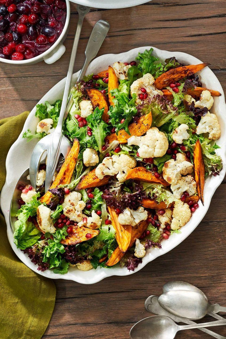 "<p>Who says salads have to be boring? Amp up your greens with warm, roasted vegetables and pomegranate seeds. </p><p><strong><a href=""https://www.countryliving.com/food-drinks/recipes/a40029/sweet-potato-and-cauliflower-salad-recipe/"" rel=""nofollow noopener"" target=""_blank"" data-ylk=""slk:Get the recipe"" class=""link rapid-noclick-resp"">Get the recipe</a>.</strong></p><p><strong><a class=""link rapid-noclick-resp"" href=""https://www.amazon.com/Pioneer-Woman-Transparent-Platter-Off-white/dp/B01EHDHE0O/?tag=syn-yahoo-20&ascsubtag=%5Bartid%7C10050.g.34470406%5Bsrc%7Cyahoo-us"" rel=""nofollow noopener"" target=""_blank"" data-ylk=""slk:SHOP SERVING DISHES"">SHOP SERVING DISHES</a><br></strong></p>"
