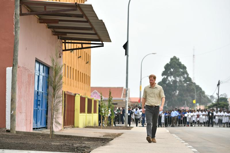 The Duke of Sussex walks on Princess Diana Street in Huambo, Angola, on day five of the royal tour of Africa. The Duke is visiting the minefield where his late mother, the Princess of Wales, was photographed in 1997, which is now a busy street with schools, shops and houses.