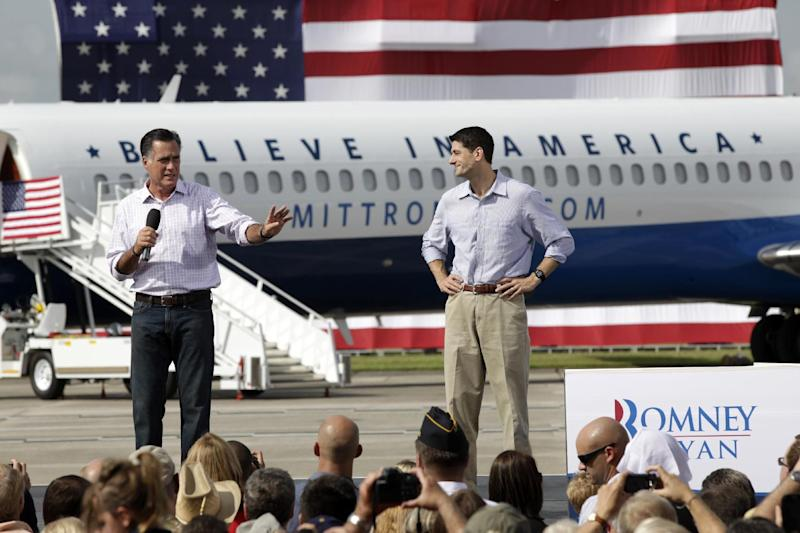 Republican presidential candidate Mitt Romney, accompanied by his vice presidential running mate Rep. Paul Ryan, R-Wis., speaks during a campaign event at Lakeland Linder Regional Airport in Lakeland, Fla., Friday, Aug. 31, 2012.  (AP Photo/Mary Altaffer)