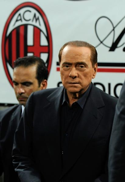 Silvio Berlusconi is seen on the pitch after AC MIlan won the Trophee Luigi Berlusconi match against Juventus on August 21, 2011, at the San Siro stadium in Milan