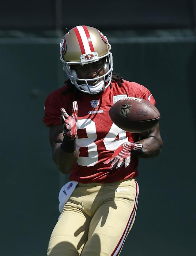 San Francisco 49ers wide receiver Brandon Lloyd (84) catches a pass during NFL football mini-camp in Santa Clara, Calif., Tuesday, June 17, 2014. (AP Photo/Jeff Chiu)