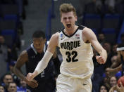 <p>Purdue's Matt Haarms celebrates a scored basket as Old Dominion's Justice Kithcart (2) follows at left during the second half of a first round men's college basketball game in the NCAA Tournament, Thursday, March 21, 2019, in Hartford, Conn. Purdue won 61-48. (AP Photo/Elise Amendola) </p>