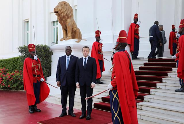 French President Emmanuel Macron is greeted by Senegalese President Macky Sall at the presidential palace in Dakar, Senegal, February 2, 2018. REUTERS/Ludovic Marin/Pool