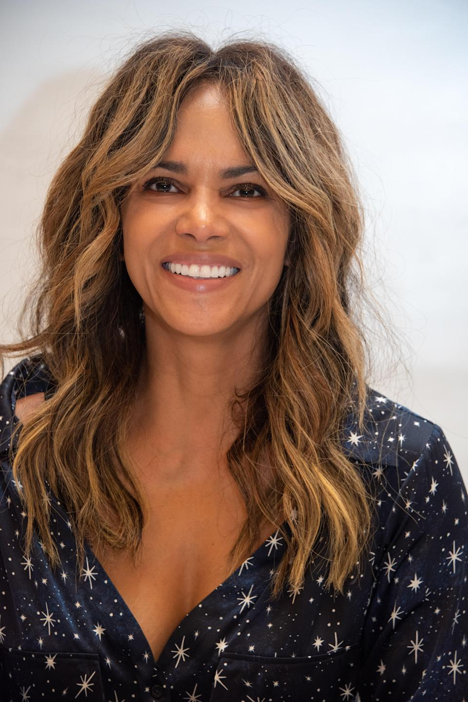 """Keep all your length but add some choppier layers around your face like Halle Berry. Embrace the mermaid feel of this cut by air-drying with plenty of <a href=""""https://www.glamour.com/gallery/best-hair-texture-sprays?mbid=synd_yahoo_rss"""" rel=""""nofollow noopener"""" target=""""_blank"""" data-ylk=""""slk:salt spray"""" class=""""link rapid-noclick-resp"""">salt spray</a>."""