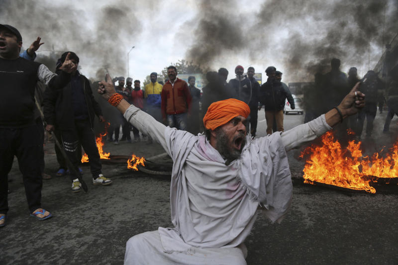 A protestor shouts slogans against Thursday's attack on a paramilitary convoy, in Jammu, India, Friday, Feb.15, 2019. The death toll from a car bombing on the paramilitary convoy in Indian-controlled Kashmir has climbed at least 40, becoming the single deadliest attack in the divided region's volatile history, security officials said Friday. (AP Photo/Channi Anand)