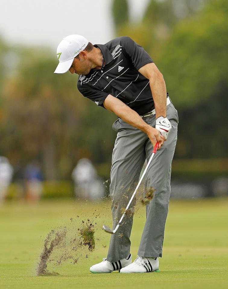 MIAMI, FL - MARCH 08:  Sergio Garcia of Spain hits his approach shot on the sixth hole during the first round of the 2012 World Golf Championships Cadillac Championship at Doral Golf Resort And Spa on March 8, 2012 in Miami, Florida.  (Photo by Mike Ehrmann/Getty Images)