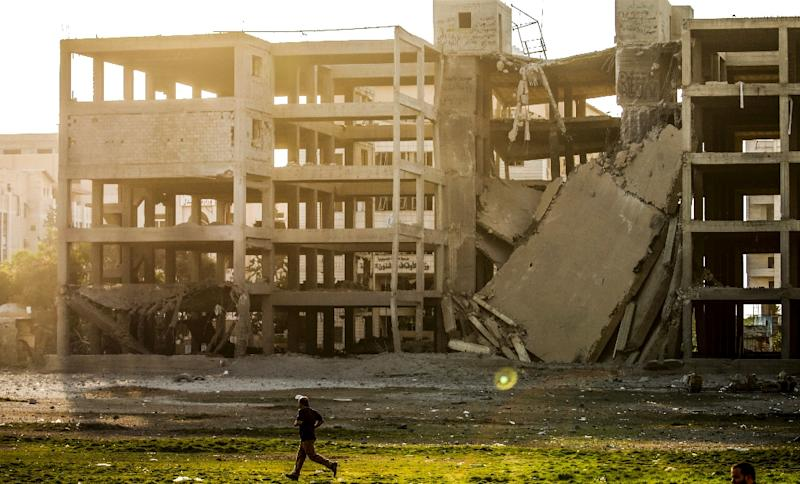 A picture taken on July 14, 2018 shows a building that was damaged by an Israeli air strike in Gaza City (AFP Photo/MAHMUD HAMS)