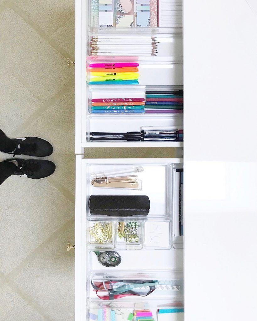 """<p>Though it's easy to think """"out of sight, out of mind,"""" a messy desk drawer does not help your productivity. Mix and match acrylic dividers so your pens, pencils, and paper clips all have a spot to live. </p><p><a href=""""http://www.simplyorganized.me/2018/01/new-home-office.html"""" rel=""""nofollow noopener"""" target=""""_blank"""" data-ylk=""""slk:Get the tutorial at Simply Organized »"""" class=""""link rapid-noclick-resp""""><em>Get the tutorial at Simply Organized »</em></a><br></p><p><strong>RELATED: </strong><a href=""""https://www.goodhousekeeping.com/home/organizing/tips/g1397/small-kitchen-storage/"""" rel=""""nofollow noopener"""" target=""""_blank"""" data-ylk=""""slk:Storage Tricks for Small Kitchens"""" class=""""link rapid-noclick-resp"""">Storage Tricks for Small Kitchens</a></p>"""