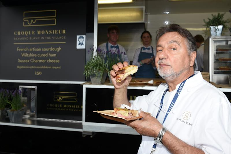 ASCOT, ENGLAND - JUNE 20: Raymond Blanc with a croque monsieur he prepared in the Village Enclosure on day 3 of Royal Ascot at Ascot Racecourse on June 20, 2019 in Ascot, England. (Photo by Stuart C. Wilson/Getty Images for Ascot Racecourse )
