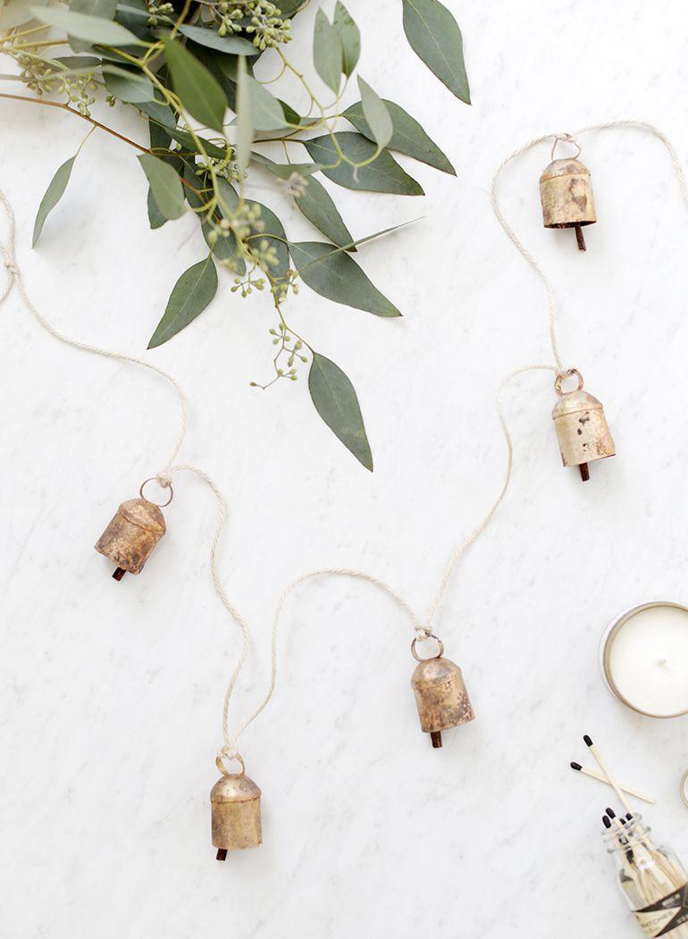 """<p>Love the modern farmhouse aesthetic? This garland, flocked with tin bells, will look right at home. </p><p><a href=""""https://themerrythought.com/diy/diy-tin-bell-garland/"""" rel=""""nofollow noopener"""" target=""""_blank"""" data-ylk=""""slk:Get the tutorial."""" class=""""link rapid-noclick-resp"""">Get the tutorial.</a></p><p><a class=""""link rapid-noclick-resp"""" href=""""https://www.amazon.com/IYOKA-Natural-Wrapping-Gardening-Applications/dp/B088R8SX9S?tag=syn-yahoo-20&ascsubtag=%5Bartid%7C10072.g.37499128%5Bsrc%7Cyahoo-us"""" rel=""""nofollow noopener"""" target=""""_blank"""" data-ylk=""""slk:SHOP TWINE"""">SHOP TWINE</a></p>"""