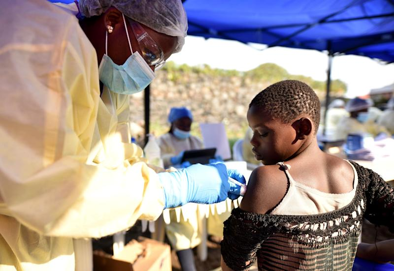 A Congolese health worker administers ebola vaccine to a child at the Himbi Health Centre in Goma, Democratic Republic of Congo.